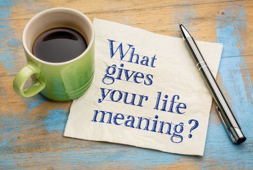 coffee pen and paper saying what gives your life meaning