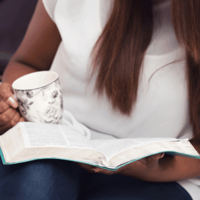 lady with coffee cup and bible in lap