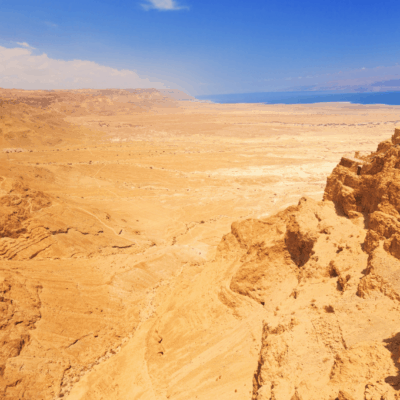 wilderness desert with sea in the distance to the top right