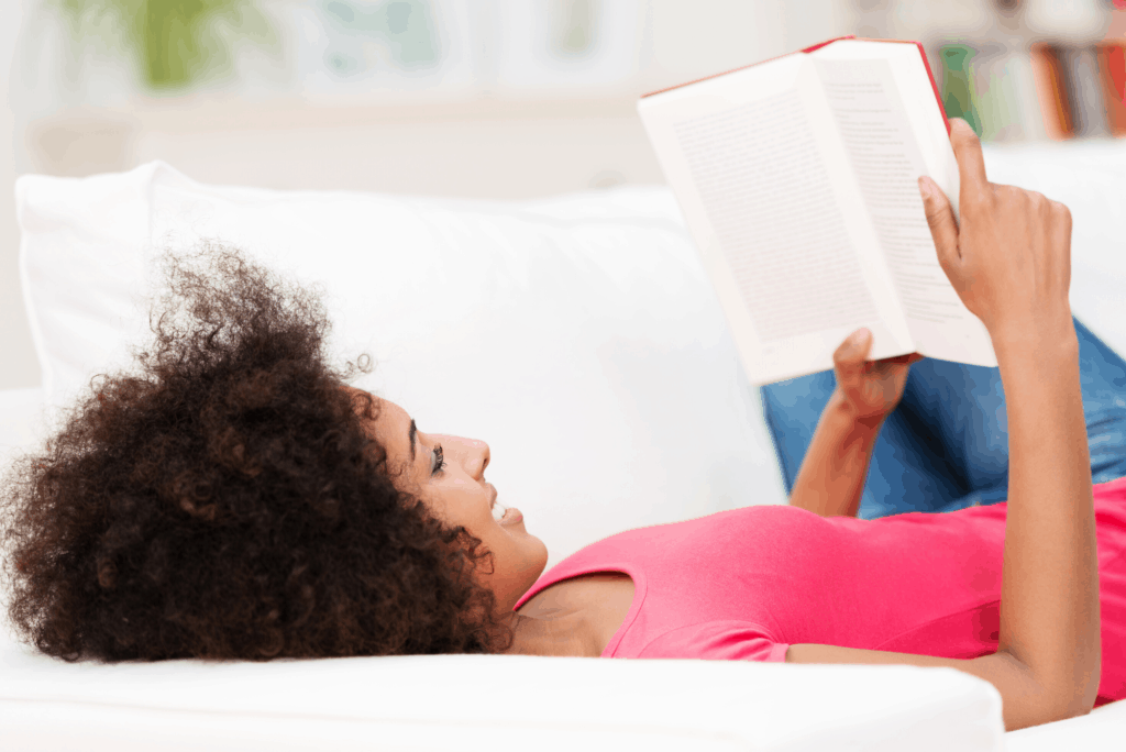 woman lying on back reading book